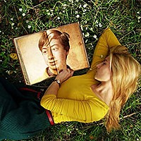 Photo effect - Girl is lying on the grass