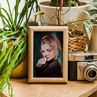 Photo effect - Wooden photo frame on the wooden table
