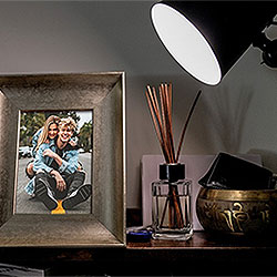 Photo effect - Bronze photo frame under the light of a lamp