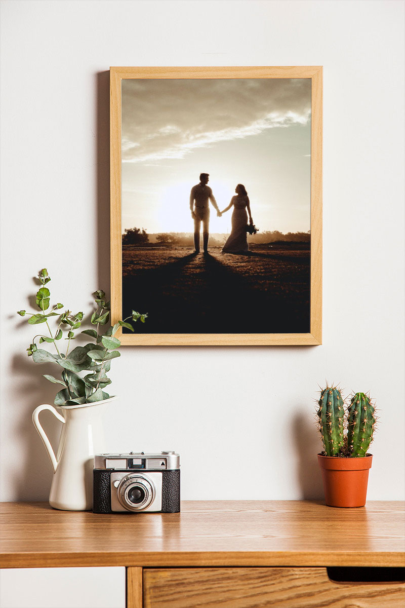 Photo effect - Wooden photo frame on the white wall